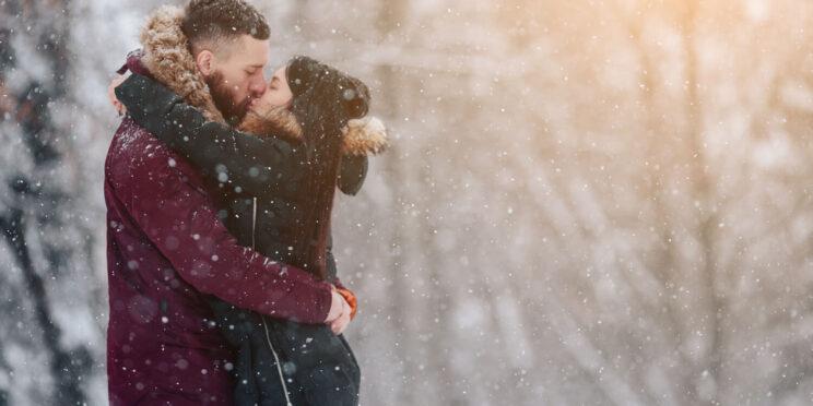 Picture of couple enjoying their winter Gun Lake cottage rental.