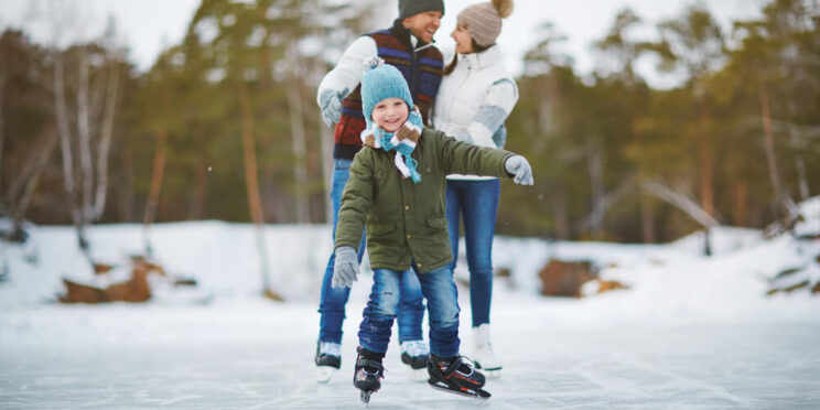 Picture of family enjoying winter in Michigan.