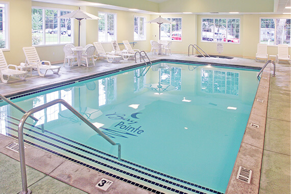 A photo of a pool at a hotel to relax in after exploring west Michigan hiking trails.