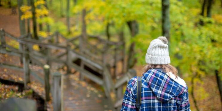 A photo of a woman exploring West Michigan hiking trails.